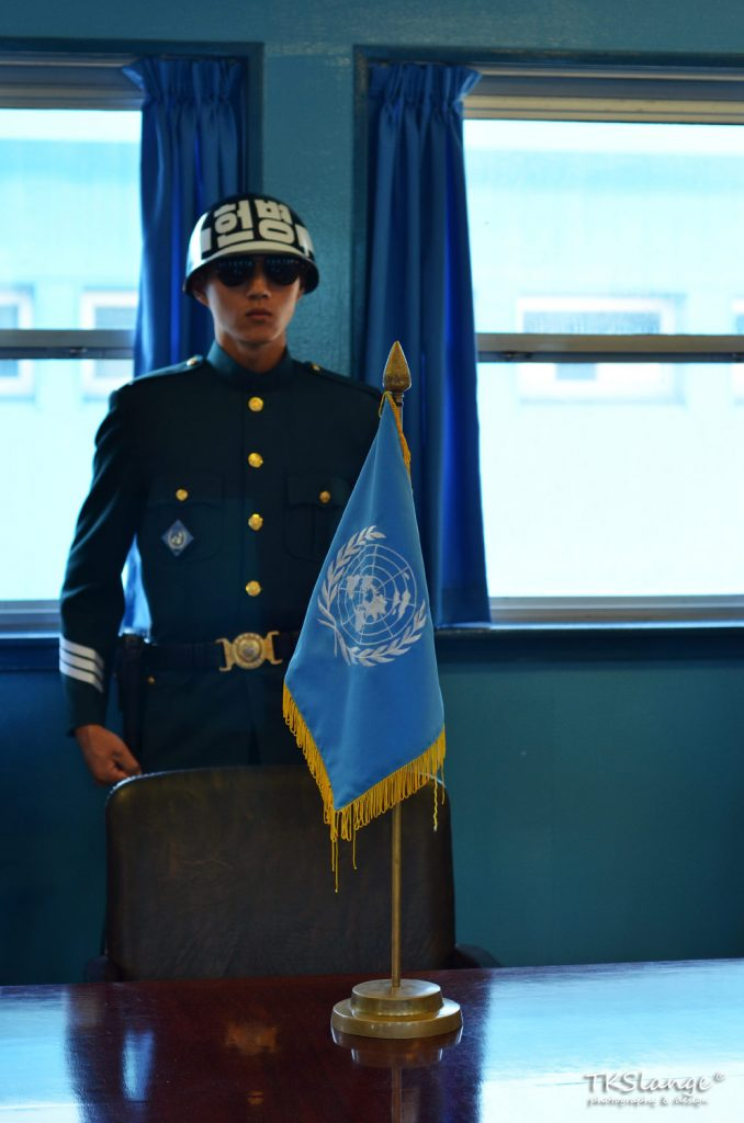 ROK soldier in the UNMAC Conference Building. The UN flag is placed in the centre of the table, which marks the MDL. To the left is South Korea, to the right North Korea.