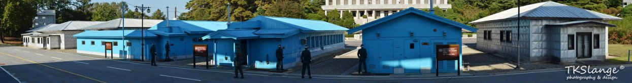 Panoramic picture of the JSA with the blue UN buildings and the North Korean 'visitors centre'.