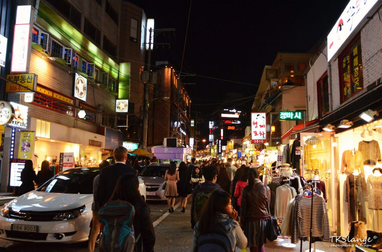 Busy streets at night in Hongik area in Seoul.