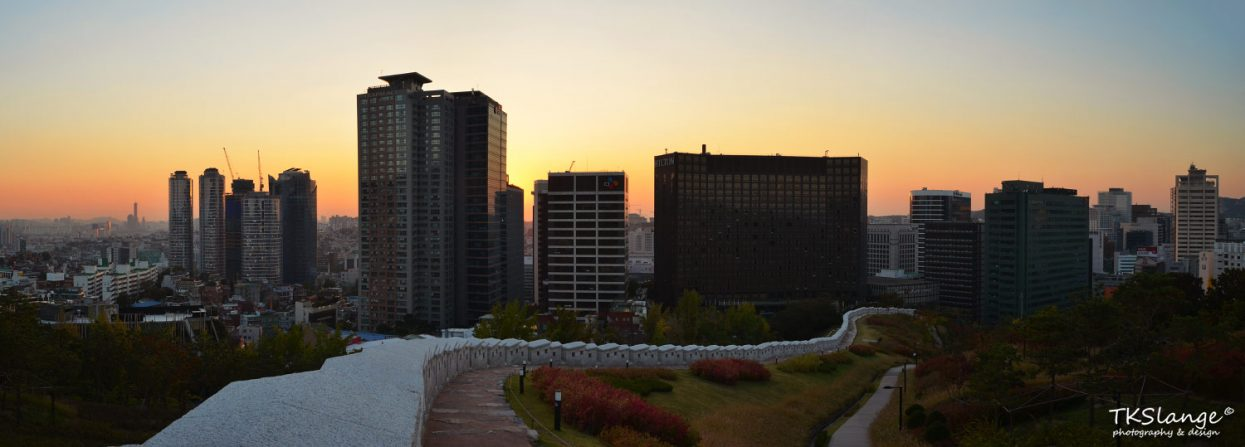 Sunset at the lower parts Namsan Park. In the front is a renovated part of the city's defence wall.