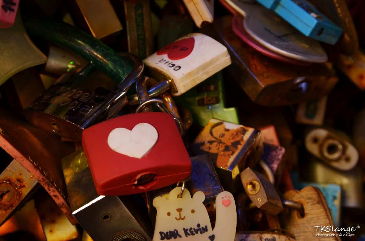 Young couples 'lock their love' at the fence of the viewing platform.