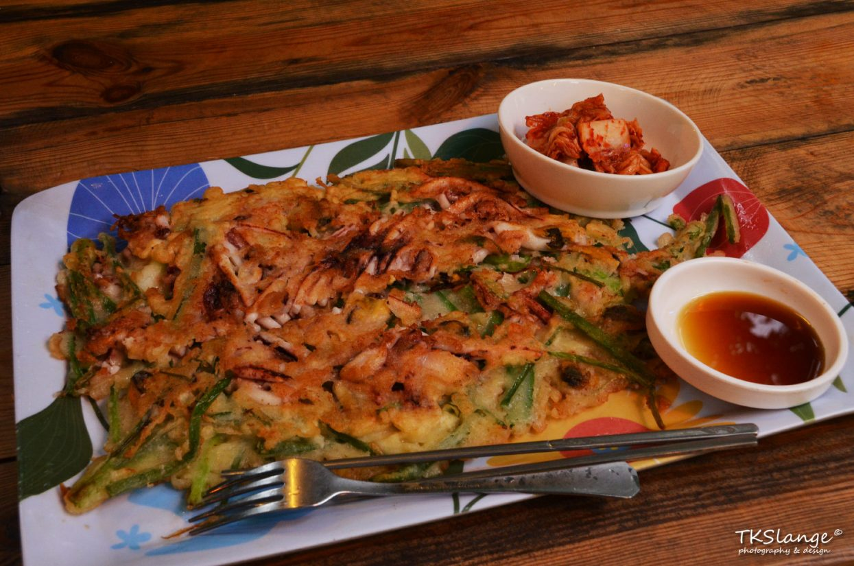 Haemul pajeon, a Korean style pancake with green unions and squid.