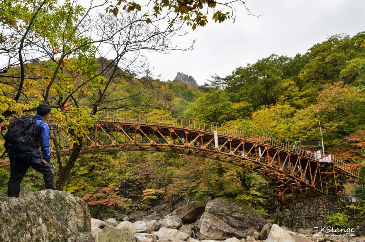 A rusty bridge at the Biseondae rocks.