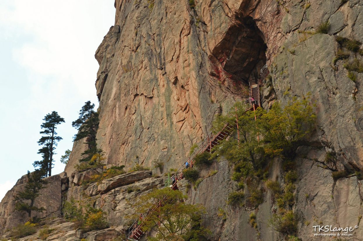 The Geumganggul sits half-way a vertical rock face and can only be reached by steep staircases.